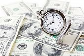 picture of money  - Silver pocket clock and money close - JPG