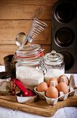 stock photo of cake-mixer  - Baking cake ingredients and cooking tools over wooden surface - JPG