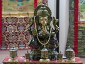 pic of ganesh  - Hindu temple with a statue of Ganesh on the altar - JPG