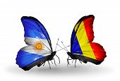 stock photo of chad  - Two butterflies with flags on wings as symbol of relations Argentina and Chad Romania - JPG