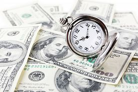 picture of time-saving  - Silver pocket clock and money close - JPG