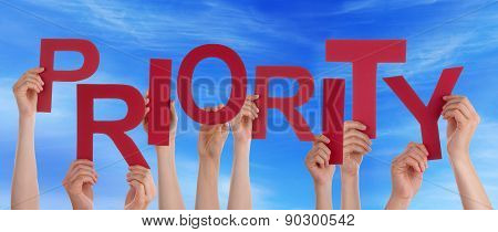 People Hands Holding Red Word Priority Blue Sky