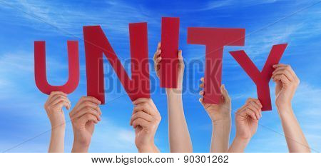 Many People Hands Holding Red Word Unity Blue Sky