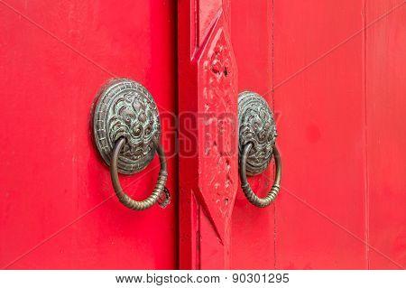 Door Knockers On The Red Door