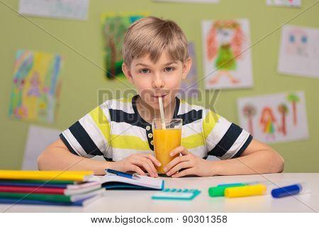Schoolboy Sitting At School Desk