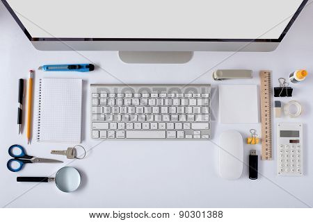 The White Office Table With Stationery Accessories, Keyboard,computer Mouse.