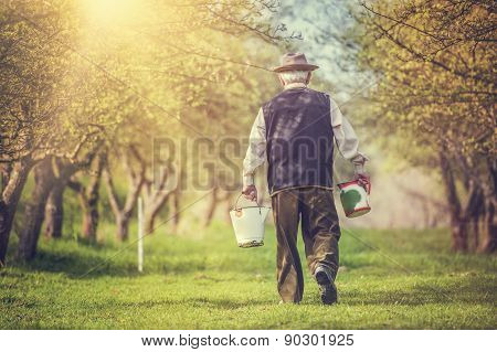 Farmer with milk bottles