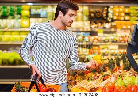 Young man shopping for vegetables