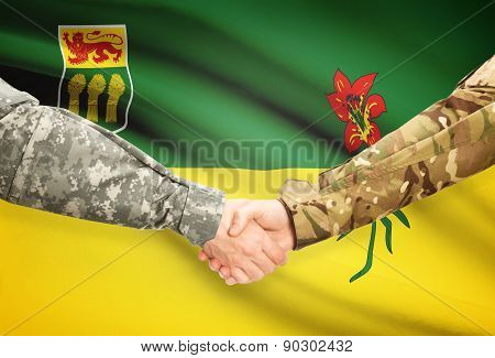 Military Handshake And Canadian Province Flag - Saskatchewan
