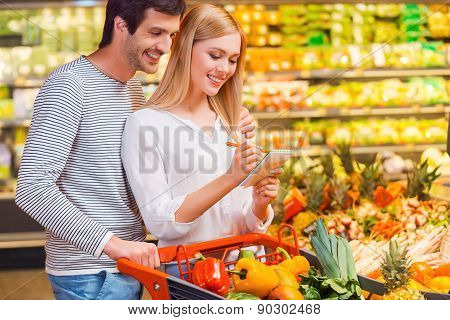Young Couple Choosing Only Healthy Food.