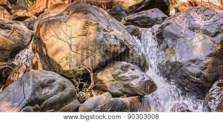 Relaxing Small Waterfall With Trees And Rocks In Mountain