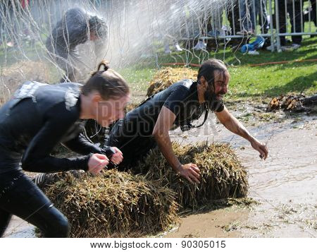 Woman And Man Fighting To Get Through The Mud, Squirted With Water