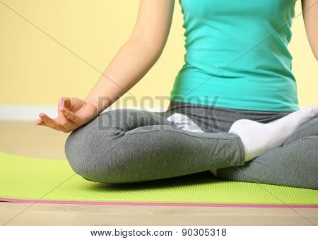 Hand yoga gesture on bright background