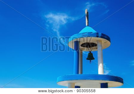 Blue white tower steeple with bell of Greek church