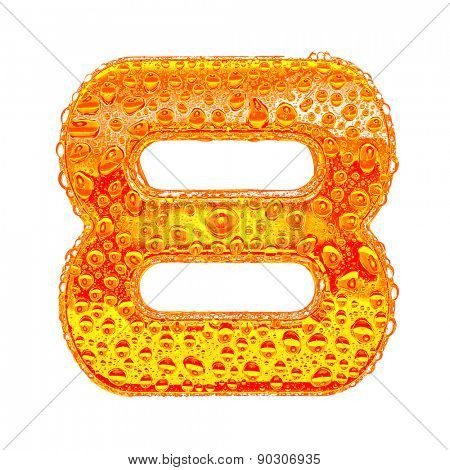 Fresh Orange alphabet symbol - digit 8. Water splashes and drops on transparent glass - color of brandy , cognac, liquor, cola, beer or tea. Isolated on white