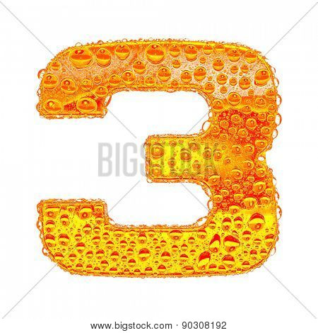 Fresh Orange alphabet symbol - digit 3. Water splashes and drops on transparent glass - color of brandy , cognac, liquor, cola, beer or tea. Isolated on white