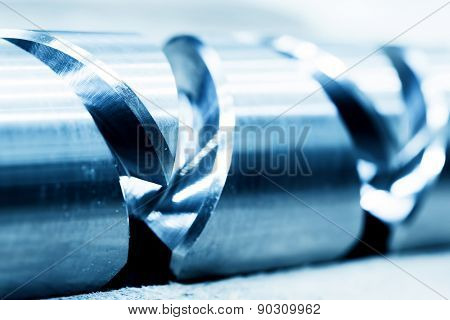 Heavy industrial element, screw. Industry, close-up background