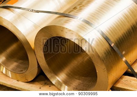 Industrial hardened steel cylinders in workshop. Industry, heavy engineering.