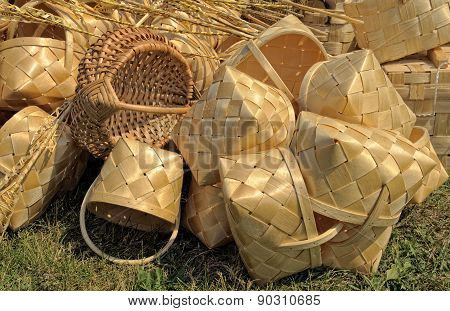 Lot of wicker baskets lie on the grass
