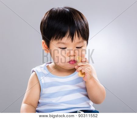 Little boy eating with finger food