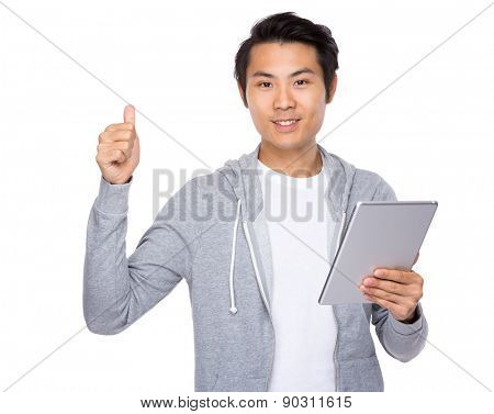 Young man hold with tablet and thumb up