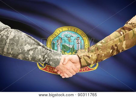 Military Handshake And Us State Flag - Idaho