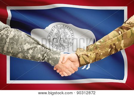 Military Handshake And Us State Flag - Wyoming