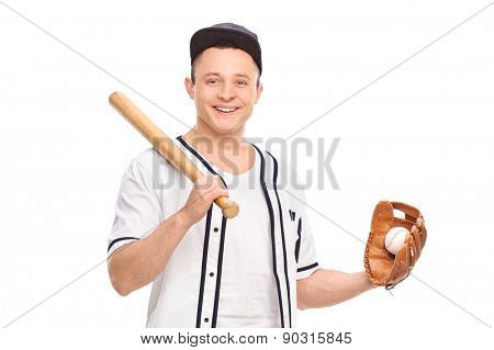 Young male baseball player holding a baseball bat and a ball isolated on white background