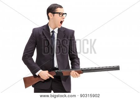 Angry man holding a rifle and shouting isolated on white background