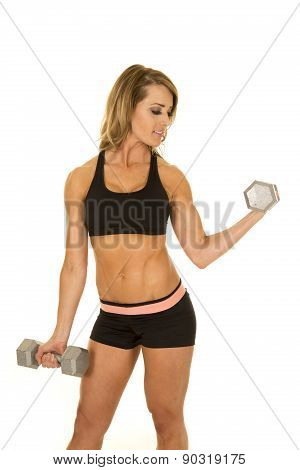 Fit Woman In Black Shorts And Top Curl Weight Look Side
