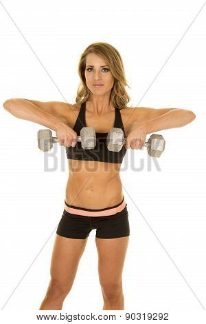 Fit Woman In Black Shorts And Top Upright Row