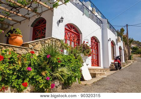 Typocal Greek house: white walls and red doors