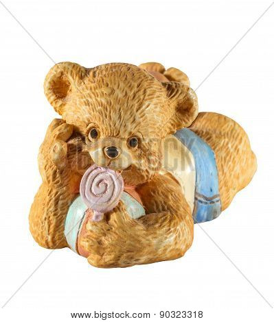statuette of cute bear with candy