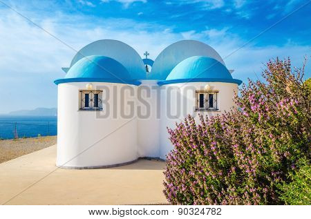 Church with iconic blue roof on Greek island