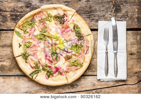 Sliced Pizza Served With Silverware