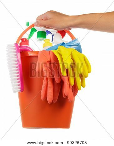 Hand with cleaning items