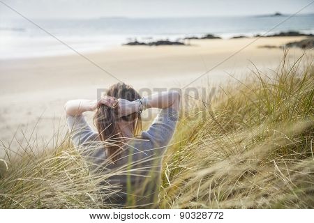 Woman Sitting In Dunes