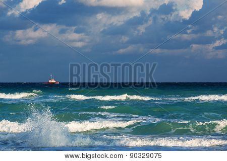 boat in the sea amid a thundercloud