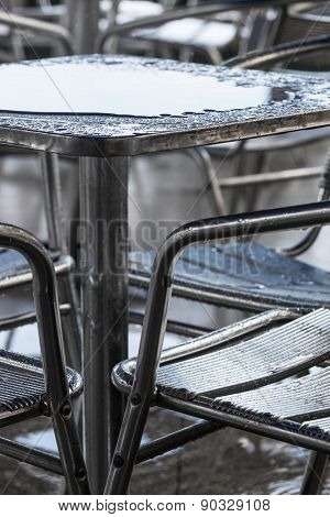 rain puddle on the table in a cafe