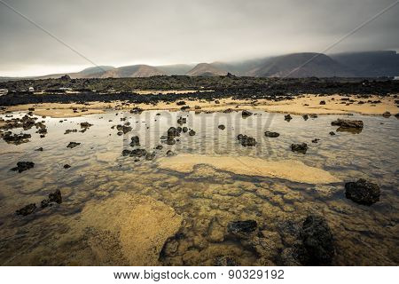 beautiful desert mountain landscape with water on the island of Lanzarote, Canary Islands