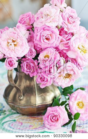 roses in a vintage jug .