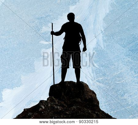 Silhouette Of Man On Peak Of Mountain
