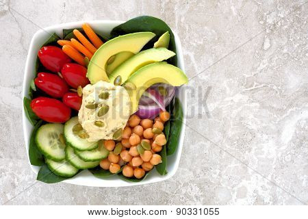 Lunch bowl with fresh vegetables and hummus