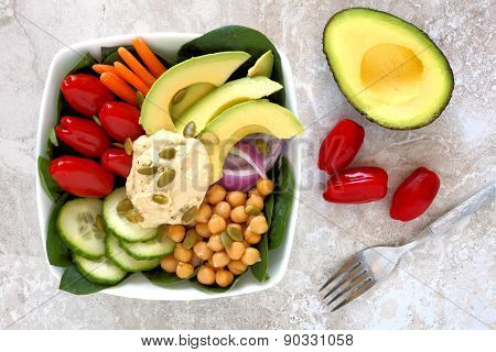 Nourishment bowl with avocado, hummus and mixed vegetables