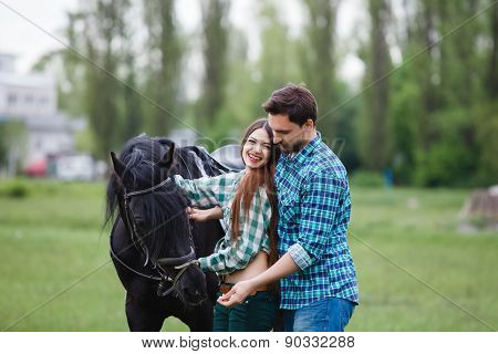 pair of lovers walk with a horse