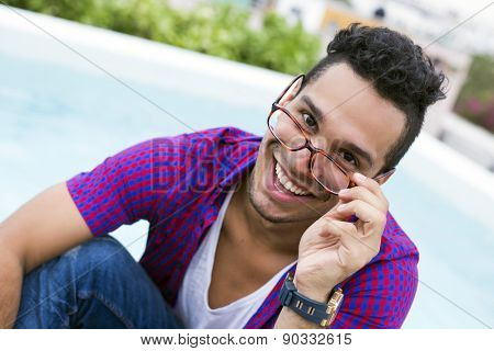 Handsome young man with hipster style and reading glasses