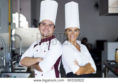 Two latin chefs in a cooking school