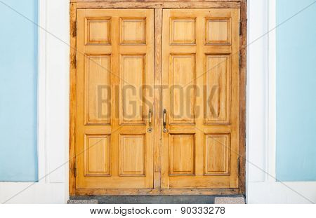 Closed Old Wooden Door In Blue White Wall