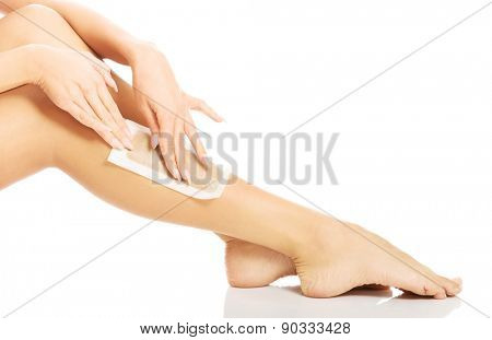 Close up of woman legs waxed.