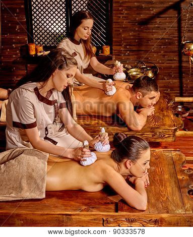 Couple  having oil Ayurveda spa treatment in India salon.